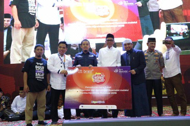 Penyalurkan bantuan dana zakat oleh Laznas Baitulmaal Muamalat dan Bank Muamalat sebesar Rp 75.000.000 melalui panitia Hijrahfest.